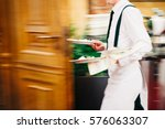 Waiter serving in motion on...