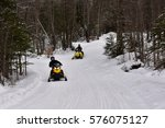 Small photo of Town of Lake Pleasant, NY - January 23, 2015 - Two snowmobiles on a trail through the Adirondack Mountains.
