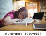 female student napping on book... | Shutterstock . vector #576095887