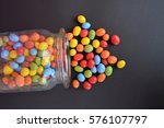 chocolate lentils in a jar on a ... | Shutterstock . vector #576107797