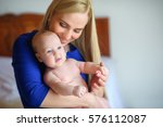 happy mother holds on hands of... | Shutterstock . vector #576112087