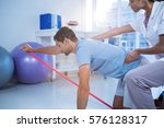 female physiotherapist... | Shutterstock . vector #576128317