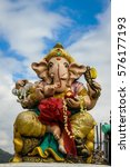 Small photo of Statue of an Indian god, Lord Ganesha: Lord of Success on blue sky background.