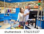 Small photo of shopping, sale, payment, consumerism and people concept - happy couple with credit card buying food at grocery store or supermarket self-service cash register