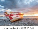 old boat on beach with dramatic ... | Shutterstock . vector #576251047