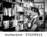 girl in a library | Shutterstock . vector #576339613