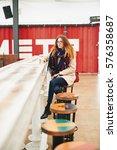 girl in glasses sitting in... | Shutterstock . vector #576358687