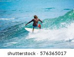 riding the waves. costa rica ... | Shutterstock . vector #576365017