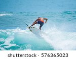 riding the waves. costa rica ... | Shutterstock . vector #576365023