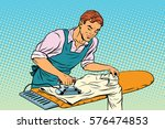 vintage employee ironed clothes.... | Shutterstock .eps vector #576474853