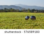 sunglasses on grass there are...