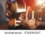 young man playing on acoustic... | Shutterstock . vector #576594247