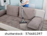 closeup of woman cleaning sofa... | Shutterstock . vector #576681397