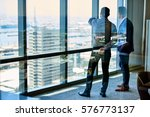 two businessmen deep in... | Shutterstock . vector #576773137