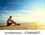 relax and enjoy music. young... | Shutterstock . vector #576806857