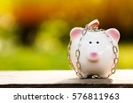 a piggy bank with security and... | Shutterstock . vector #576811963