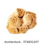 Stock photo pile of multiple melting caramel ice cream ball scoops isolated over the white background 576831247