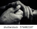hands of an elderly man holding ... | Shutterstock . vector #576882187