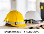 engineer hat yellow and white... | Shutterstock . vector #576892093