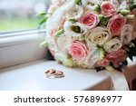 Small photo of Wedding bouquet and rings. The concept of marriage and love