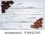 milk and black chocolate pieces ... | Shutterstock . vector #576922747