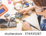 young technician working in... | Shutterstock . vector #576935287
