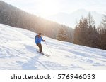 Skier In Sunset Mountains ...