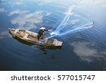 Asian Fisherman On Wooden Boat...
