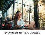 asian woman using credit card... | Shutterstock . vector #577030063
