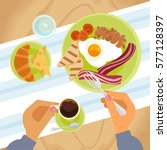 person is eating breakfast with ... | Shutterstock .eps vector #577128397