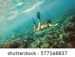 Young Woman Dives Into The...