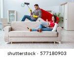 superhero husband helping his... | Shutterstock . vector #577180903