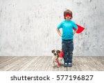 little hero with dog indoors | Shutterstock . vector #577196827
