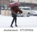 Woman With Umbrella Walking...