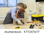 two boys with screwdrivers and... | Shutterstock . vector #577247677