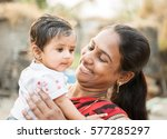 mother and child in rural... | Shutterstock . vector #577285297