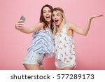 Two Cheerful Young Women With...