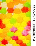 Small photo of Jujube in sugar absence star shape, colorful abstract texture background, back light, closeup