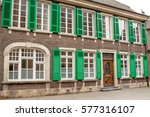 old house facade with green... | Shutterstock . vector #577316107