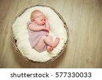 newborn girl sleeping in a... | Shutterstock . vector #577330033