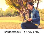 asian woman writing her note in ... | Shutterstock . vector #577371787
