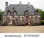 A Quaint French House With Red...