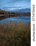 mirror surface lake autumn... | Shutterstock . vector #577475443