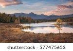 mirror surface lake autumn... | Shutterstock . vector #577475653