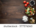 bowl of fresh salad with feta... | Shutterstock . vector #577576363
