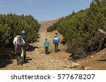 family climbing on mountain | Shutterstock . vector #577678207