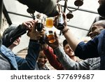 hands hold beverage beers... | Shutterstock . vector #577699687