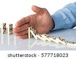 hand stopping domino falling...   Shutterstock . vector #577718023