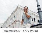 handsome man sending voice... | Shutterstock . vector #577749013