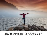 happy woman raised her arms up... | Shutterstock . vector #577791817